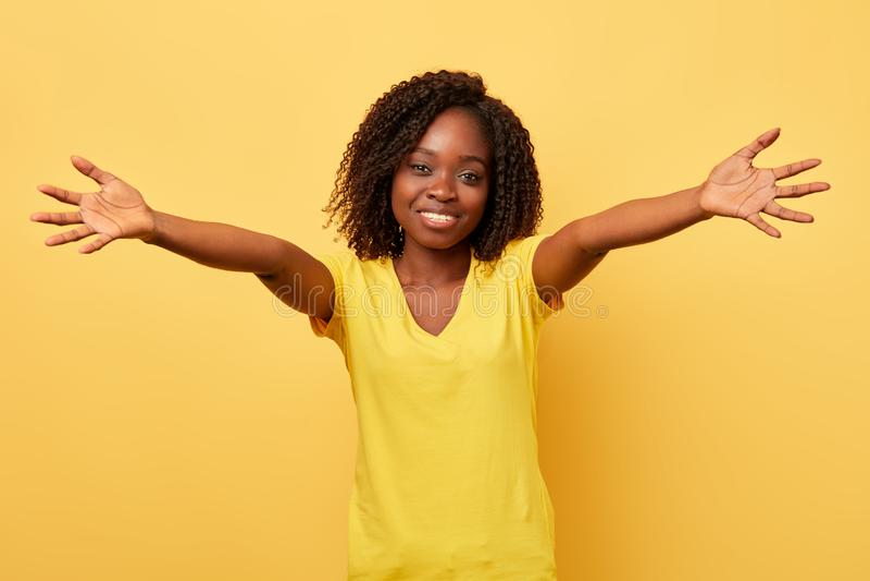 Happy charming young girl going to hug stock photo