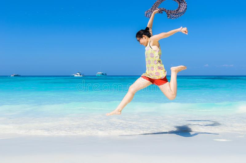 Happy and Cheerful beautiful Asian woman enjoy jumping on a whit stock photos