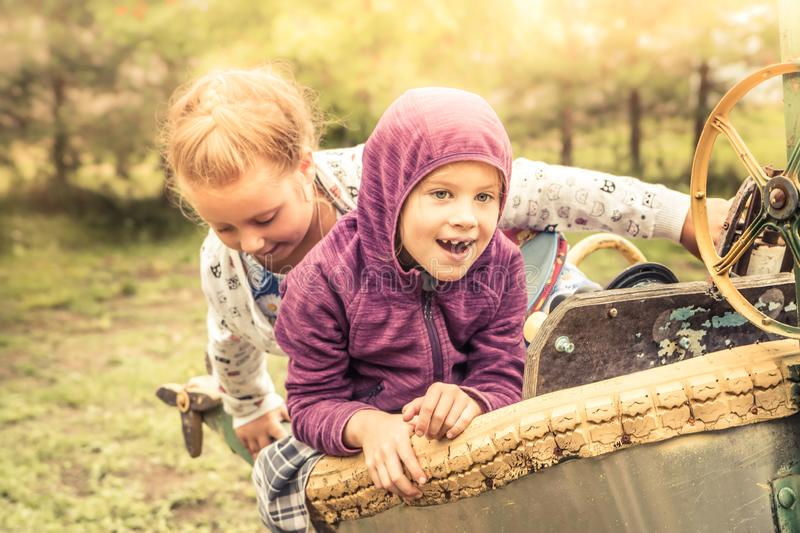 Happy cheerful chidren kids fun playing outdoors park playground yellow sunlight autumn landscape concept happy carefree childhood stock photography