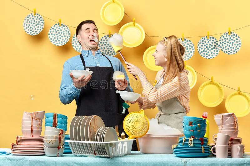 Happy cheerful couple having fun with the foam royalty free stock photo