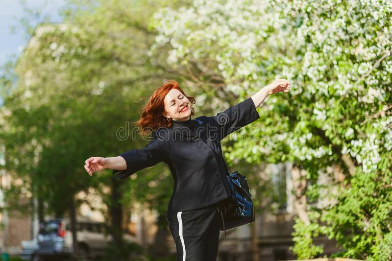 Happy cheerful forty-year-old woman outdoor stock photos