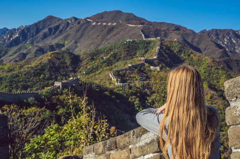 Happy cheerful joyful tourist woman at Great Wall of China having fun on travel smiling laughing and dancing during stock image