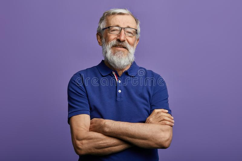 Happy cheerful man with arm crossed looking at the camera. stock image