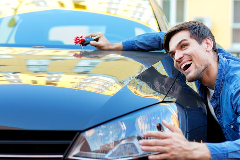 Young businessman bought new car stock images
