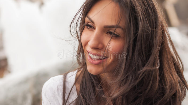 Happy cheerful smiling woman enjoys on the city streets stock photos