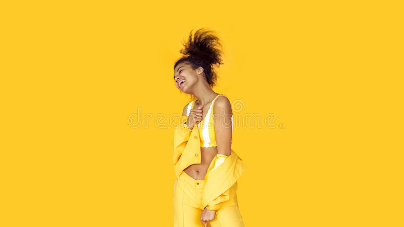 Happy african woman laugh isolated on yellow background, banner. Happy cheerful young african woman wear stylish yellow clothes laugh isolated on background stock photos