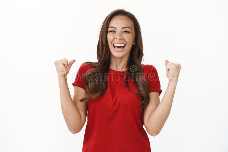 Happy cheerful young girl winning lots money, celebrating feeling like champion, fist pump laughing from happiness. Accomplish goal, triumphing achieve success stock photos