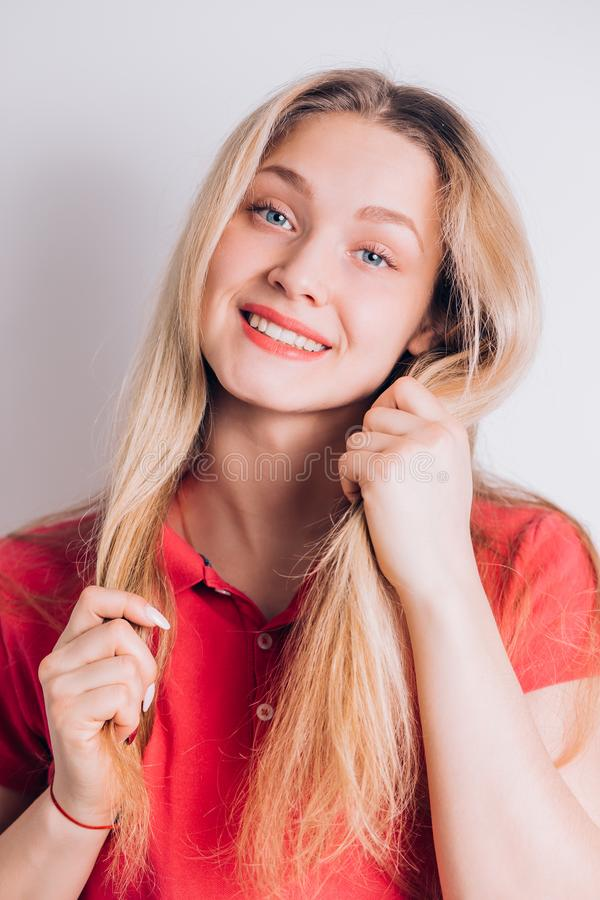 Happy cheerful young woman looking at camera with joyful and charming smile stock photo
