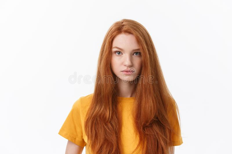Happy cheerful young woman wearing her red hair looking at camera. Ginger student girl relaxing indoors after college royalty free stock photos