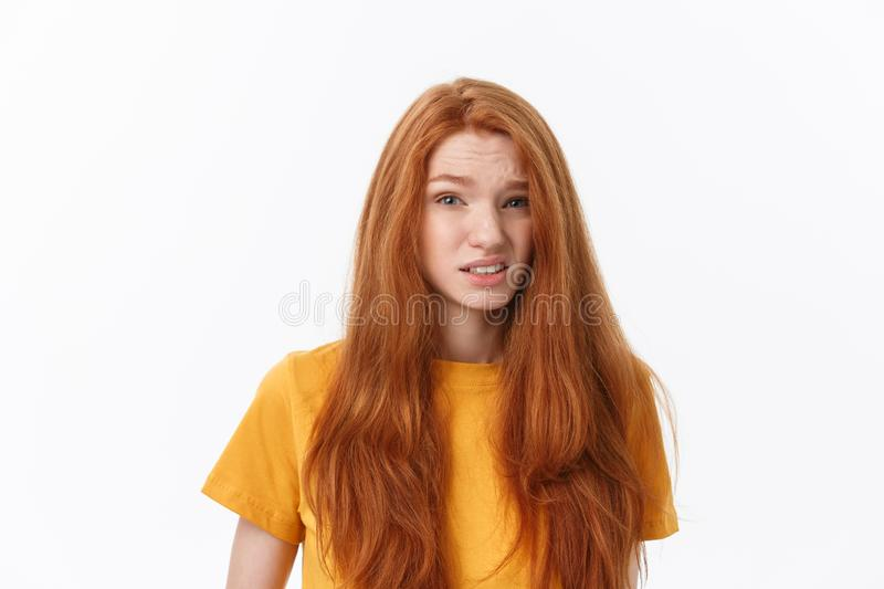 Happy cheerful young woman wearing her red hair looking at camera. Ginger student girl relaxing indoors after college stock photo