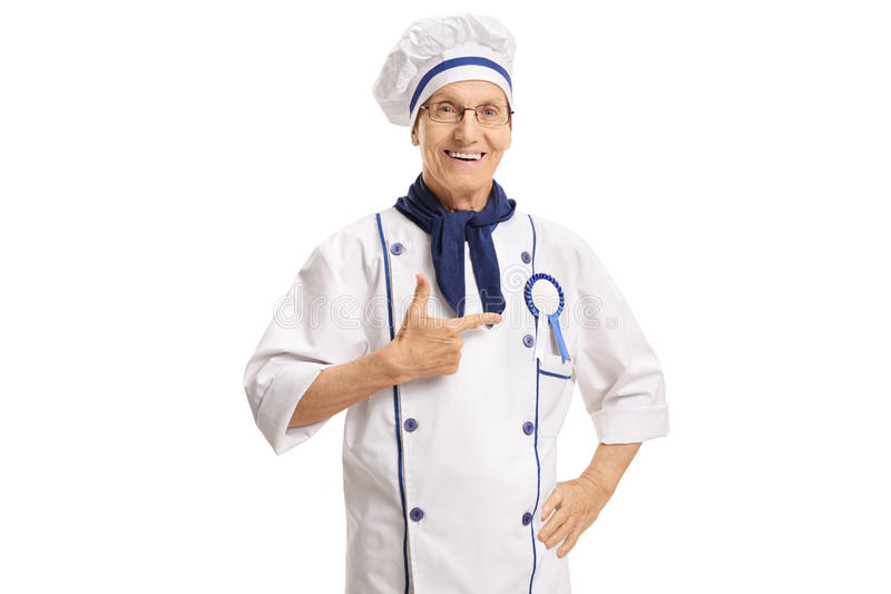 Happy chef with an award ribbon pointing. Isolated on white background royalty free stock photo