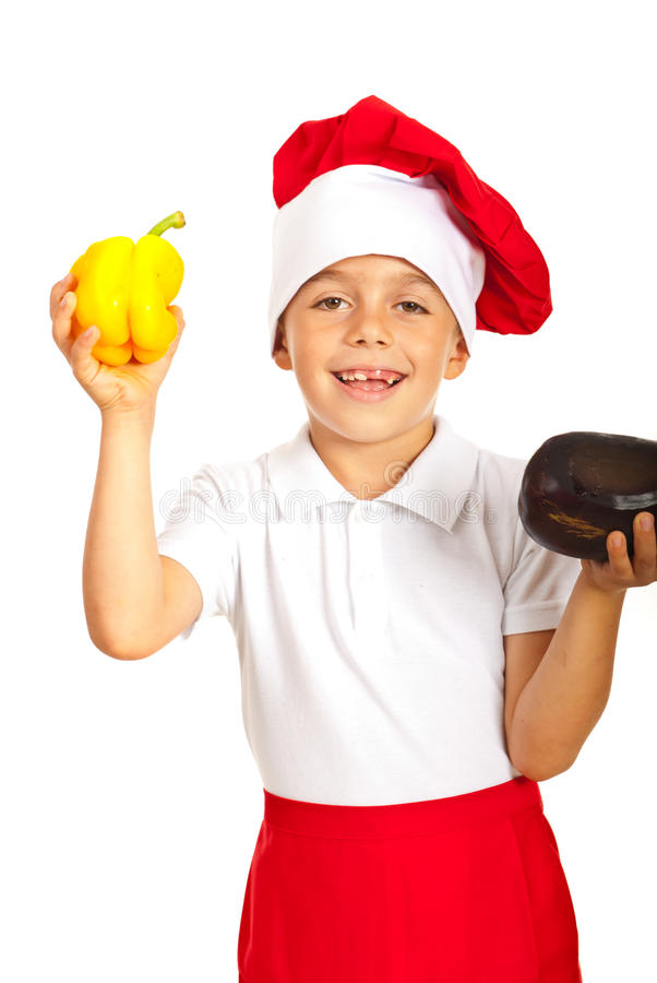 Happy chef boy showing bell pepper stock images