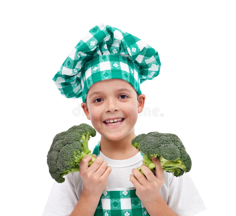 Happy chef with broccoli. Happy chef with hat and apron holding broccoli - isolated royalty free stock photography