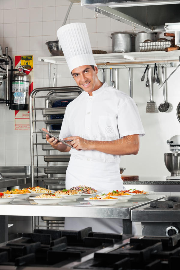Happy Chef With Digital Tablet Checking List Of royalty free stock images