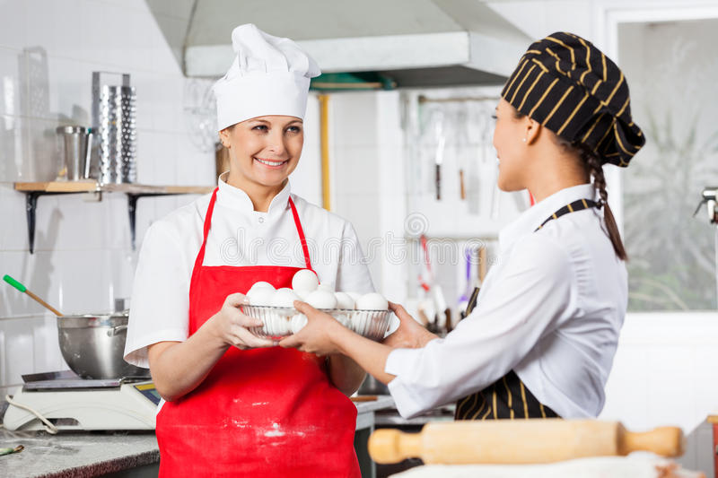 Happy Chef Giving Container Full Of Eggs To stock images