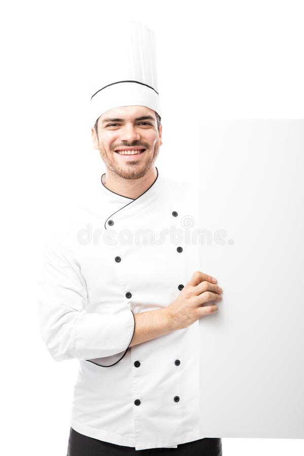 Happy chef holding a sign royalty free stock photos