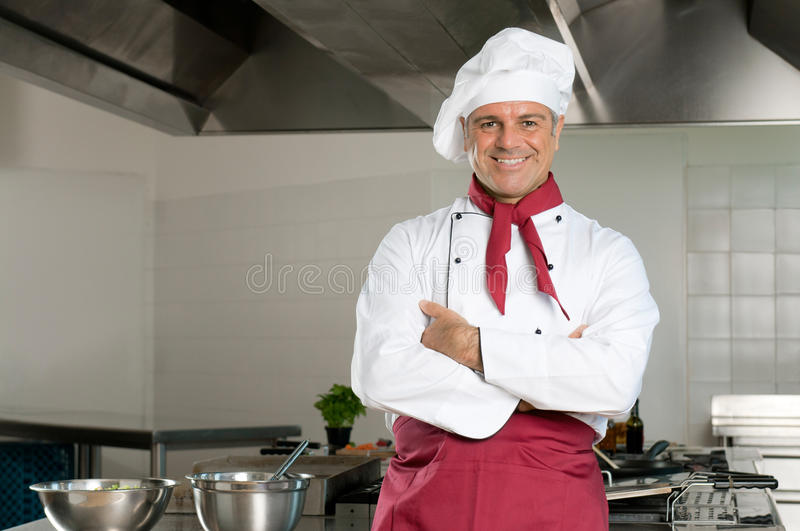 Happy chef at work stock photo
