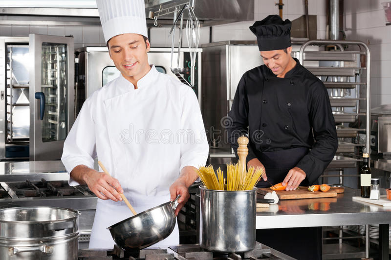 Happy Chefs Preparing Food royalty free stock images