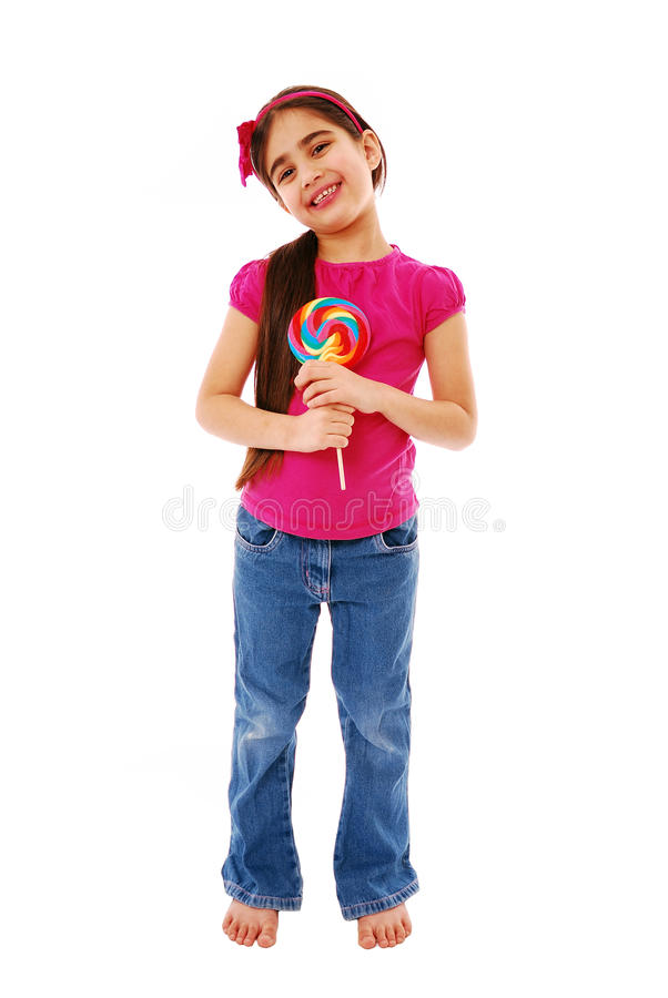 Happy child. Happy girl holding lolly pop isolated on white royalty free stock photos