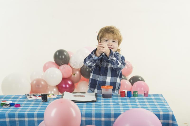 Happy child art. Cute boy painting. Kids mood concept. royalty free stock image
