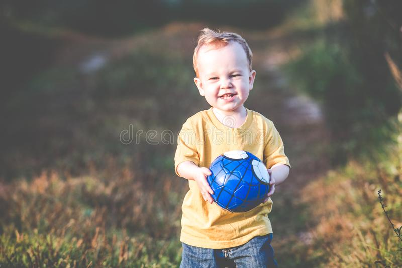 Happy child with a ball stock image