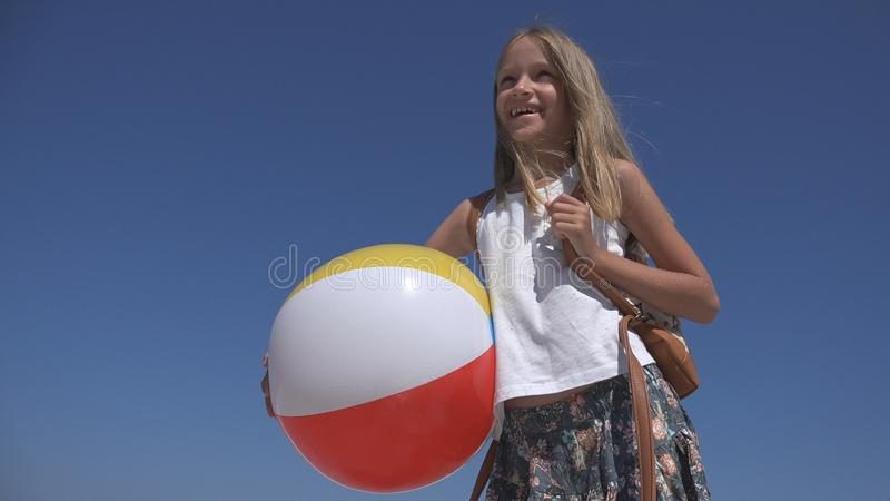 Happy Child on Beach, Kid on Seashore, Little Girl Laughing, Sea Waves Coastline royalty free stock photos