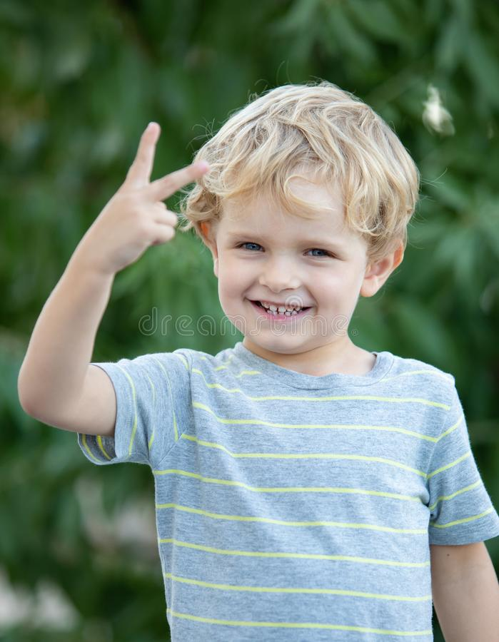 Happy child with blue t-shirt in the garden stock photos