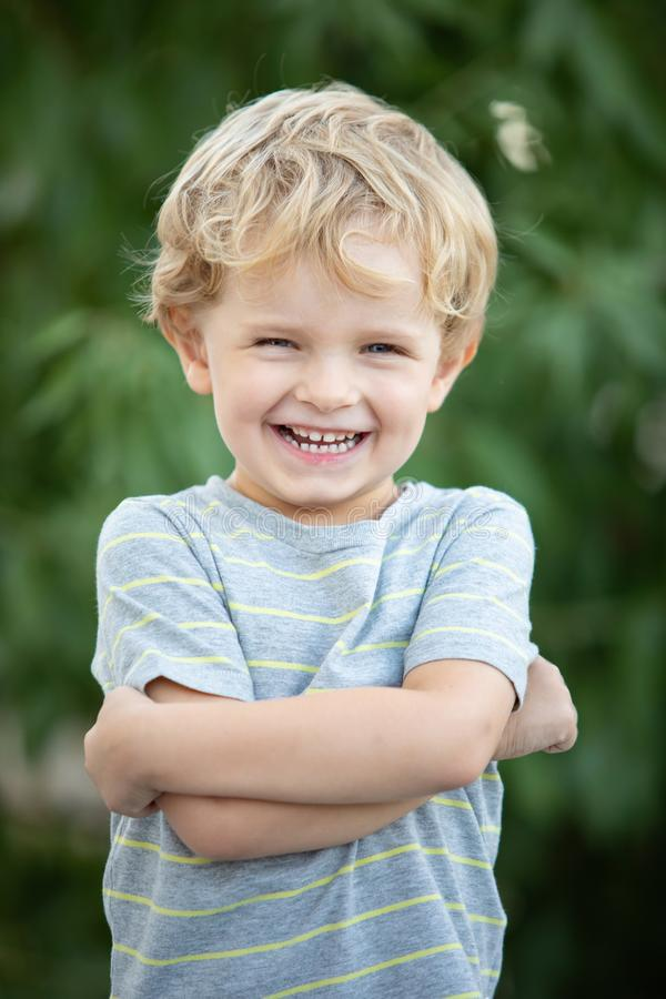 Happy child with blue t-shirt in the garden stock photography
