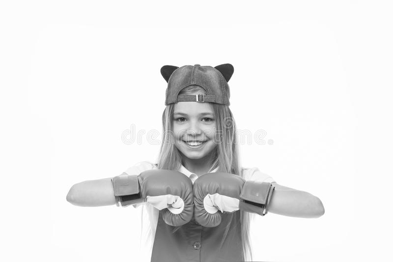 Happy child in boxing gloves isolated on white. Little girl smile before training or workout. Kid athlete in fashionable. Cap. Fashion, style and trend. Sport royalty free stock images