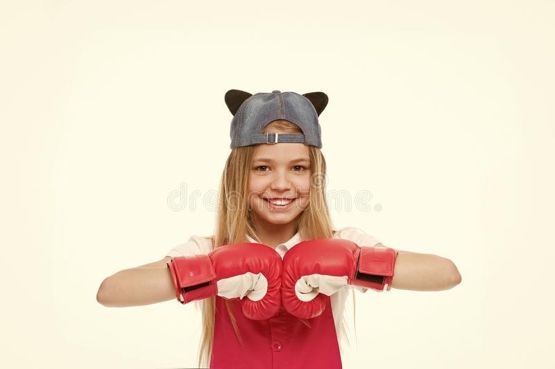 Happy child in boxing gloves isolated on white. Little girl smile before training or workout. Kid athlete in fashionable. Cap. Fashion, style and trend. Sport stock photos