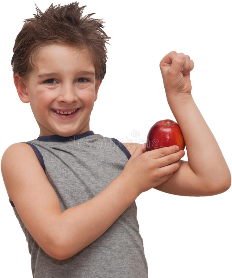 Happy child boy showing muscle apple royalty free stock photos