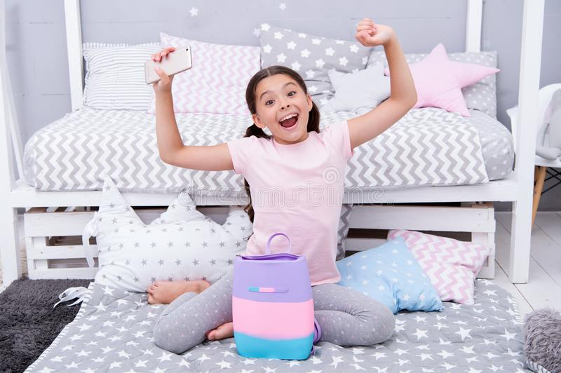 Happy child concept. Happy little girl child with gift bag. Happy child got smartphone for present. Happy birthday stock photography