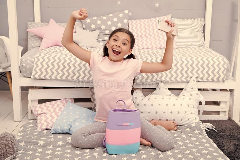 Happy child concept. Happy little girl child with gift bag. Happy child got smartphone for present. Happy birthday. Celebration for child royalty free stock photos