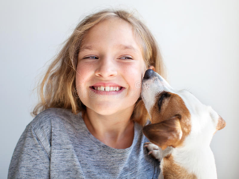 Happy child with dog stock images
