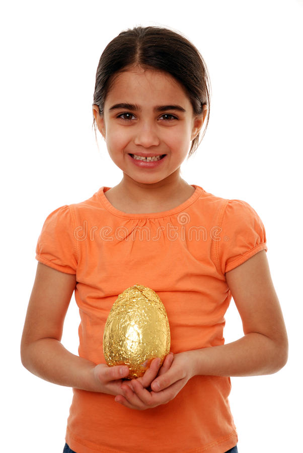 Happy child with Easter egg stock images