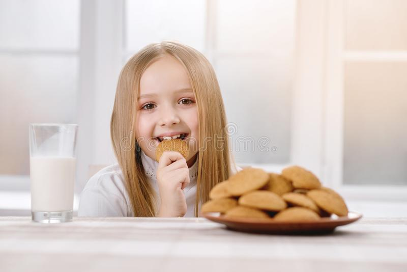Happy child eats cookie. royalty free stock photography