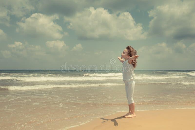 Happy child enjoying at the beach royalty free stock image