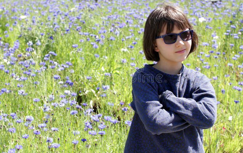 Happy child enjoying relaxing sun, observing nature at springtime royalty free stock image