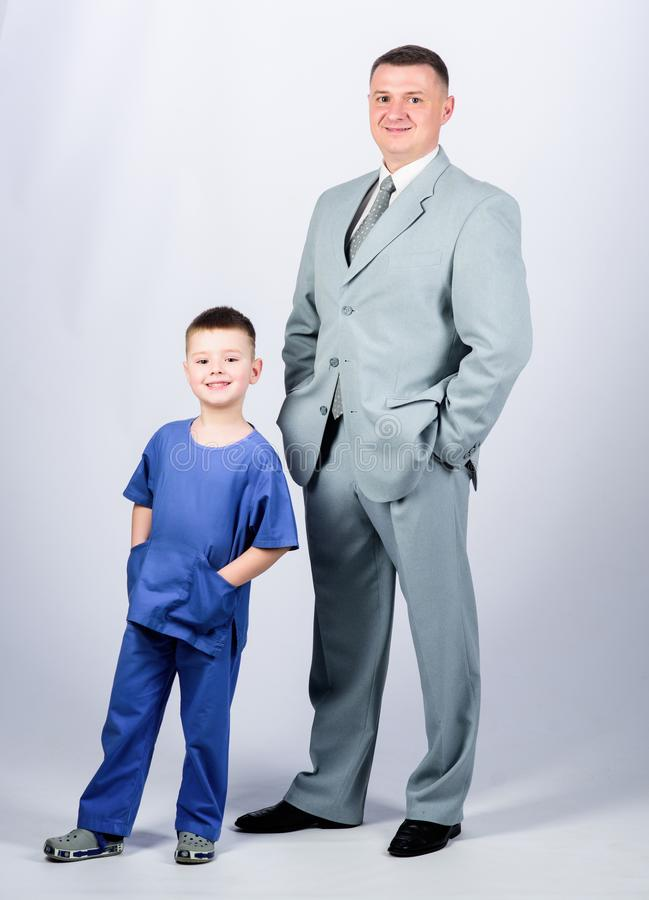 Happy child with father. business partner. small boy doctor with dad businessman. childhood. trust and values. fathers. Day. family day. father and son in stock images