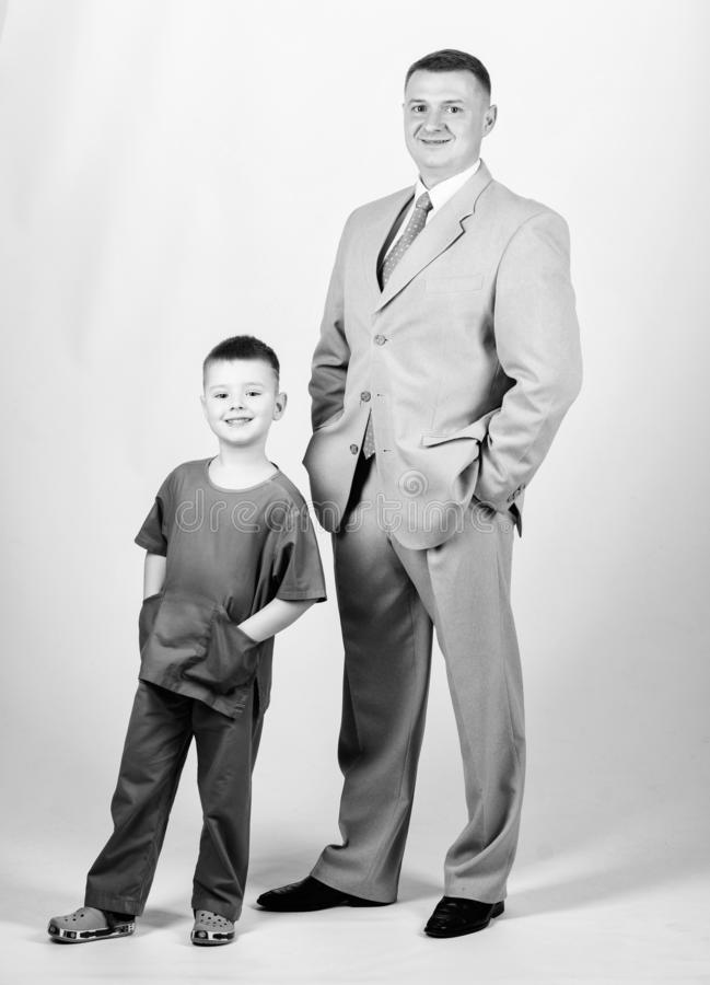 Happy child with father. business partner. small boy doctor with dad businessman. childhood. trust and values. fathers. Day. family day. father and son in stock photography