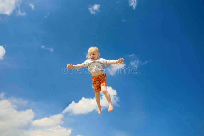 Happy child fly in the sky stock image