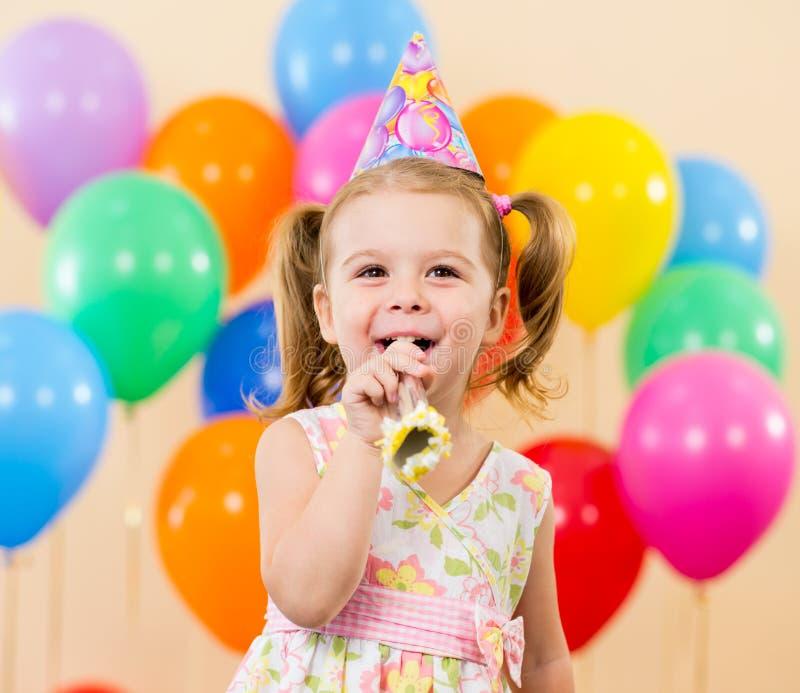 Happy child girl on birthday party. Pretty joyful kid girl on birthday party stock image
