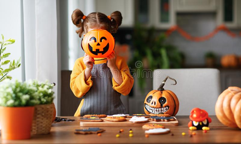 Happy child girl in costumes of pumpkins are preparing for holi stock image