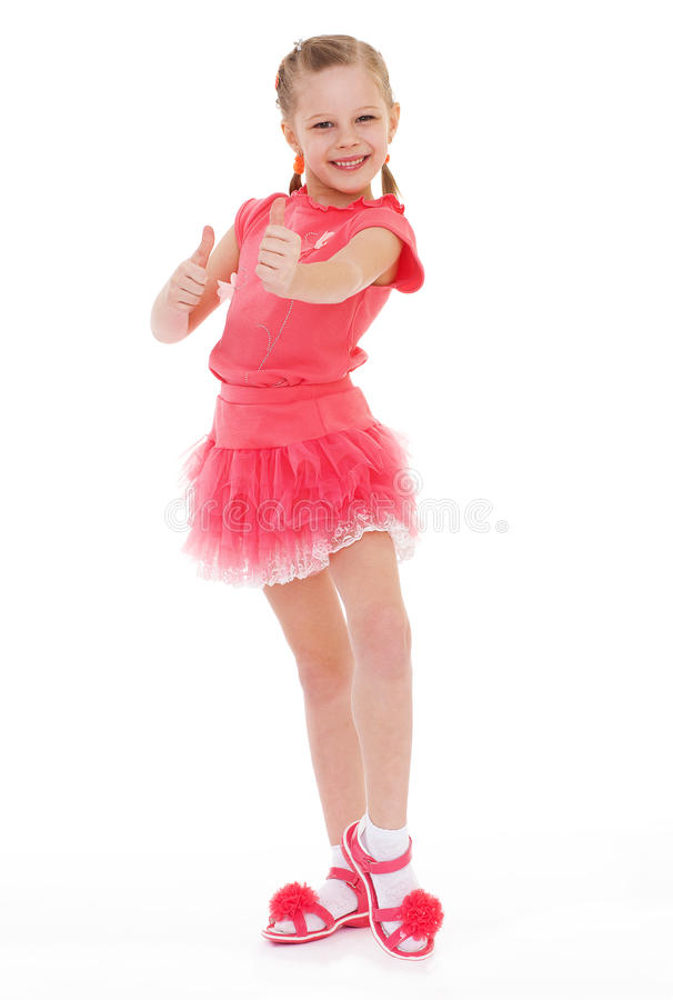 Happy child girl with hands thumbs up. Isolated on white background stock photo