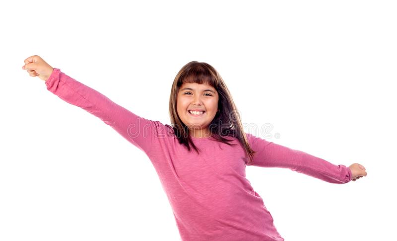 Happy child girl with pink t-shirt stretching her arms stock photography