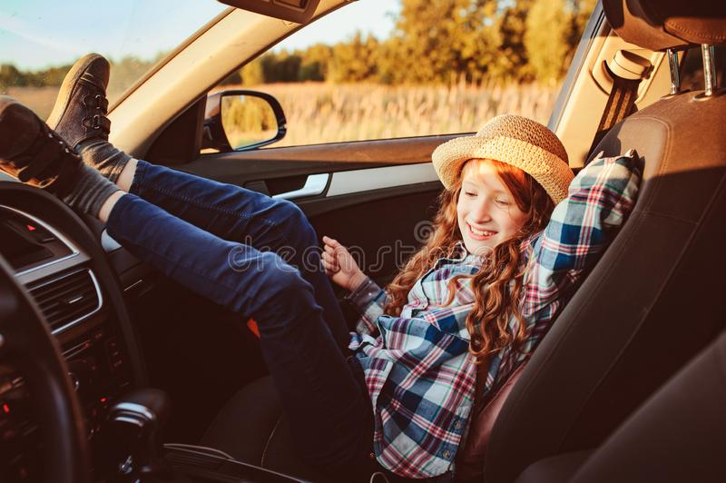 Happy child girl relaxing in car during summer road trip. royalty free stock photos