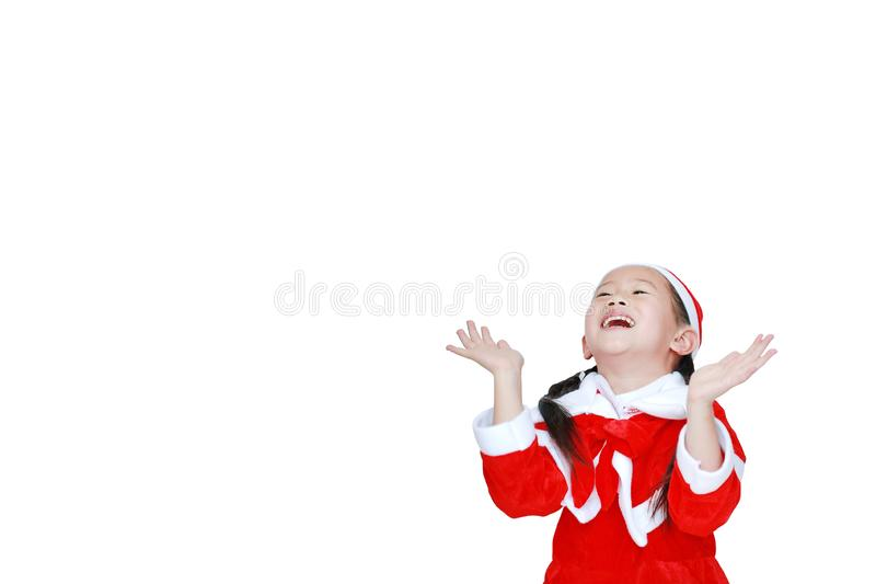 Happy child girl in Santa costume dress with copy space on white background. Merry Christmas and Happy New Year Concept.  royalty free stock images