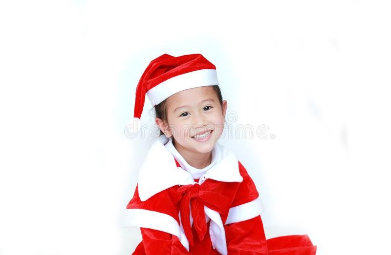 Happy child girl in Santa costume dress with copy space on white background. Merry Christmas and Happy New Year Concept.  stock images