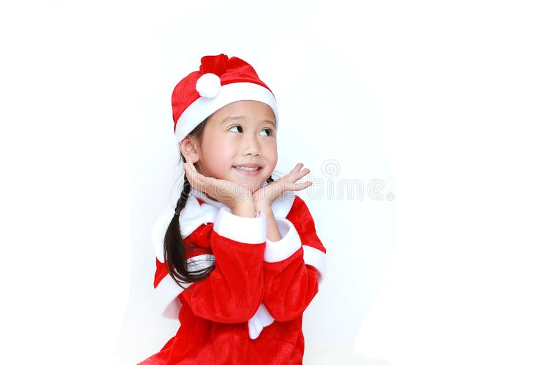 Happy child girl in Santa costume dress with copy space on white background. Merry Christmas and Happy New Year Concept.  royalty free stock photos