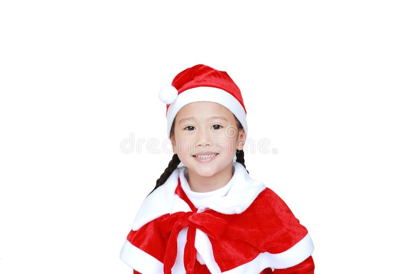 Happy child girl in Santa costume dress with copy space on white background. Merry Christmas and Happy New Year Concept.  stock image